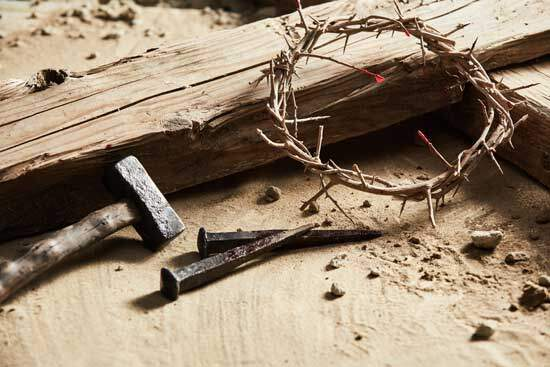 Crown of thorns, iron nails & hammer near a wodden cross, as Jesus was rejected & crucified - AAAF