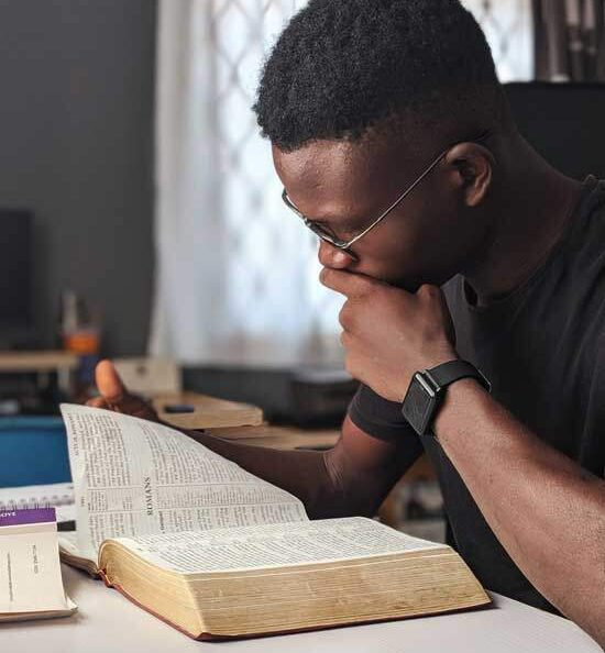 Man studying Bible as Adventists believe reading & studying the Bible is key to growing relationship with God