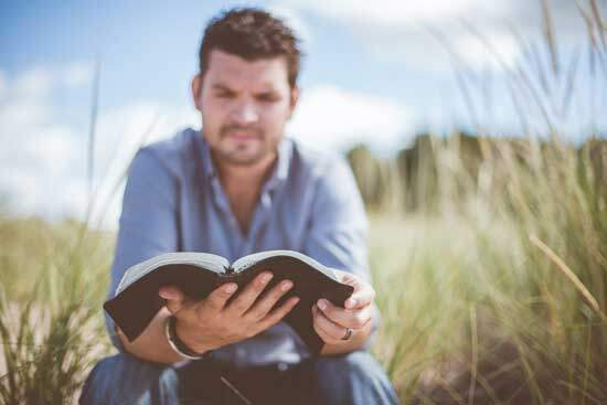 """Man reading Bible as Psalmist says in Psalm 119:11 """"Your word I have hidden in my heart, that I might not sin against You"""""""