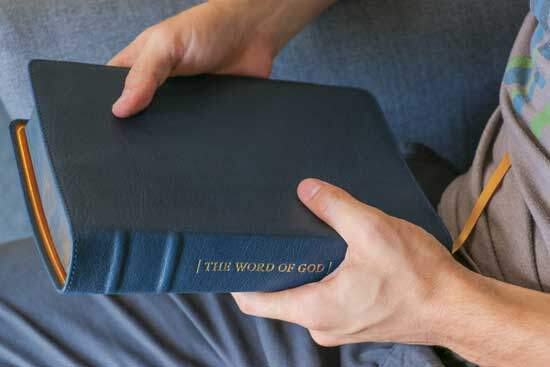 Man holding the Bible, the written Word of God which introduces us to God & His plan of salvation