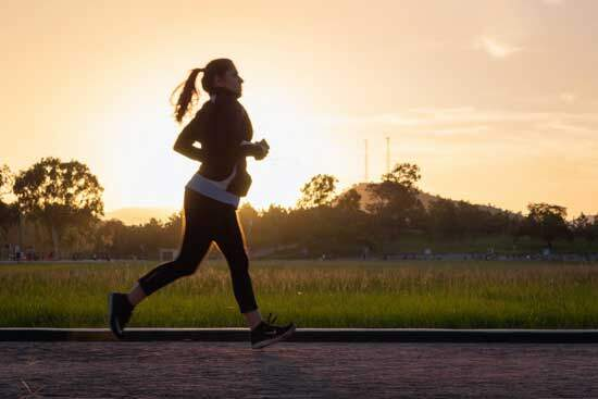 Woman running as part of her daily exercise since Adventists believe that consistent exercise can bring great health benefits