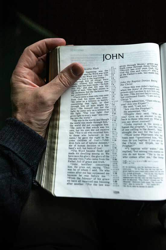 """Bible open at John 1:1-3 - """"In the beginning was the Word [Jesus], and the Word was with God, and the Word was God."""