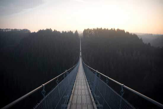 Bridge across a valley just as the deity of Christ links Jesus to heaven & the humanity of Christ links Jesus to Earth