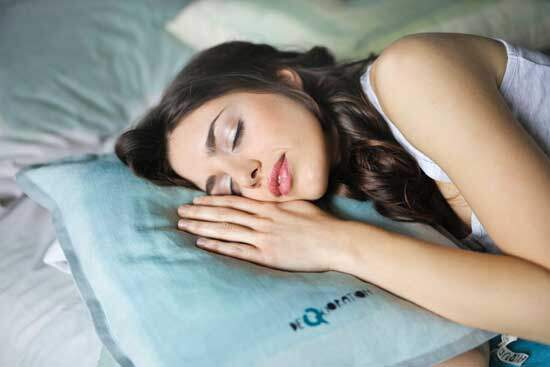 Woman sleeping as Bible compares death with a sleep which feels like a moment without the sense of the passage of time