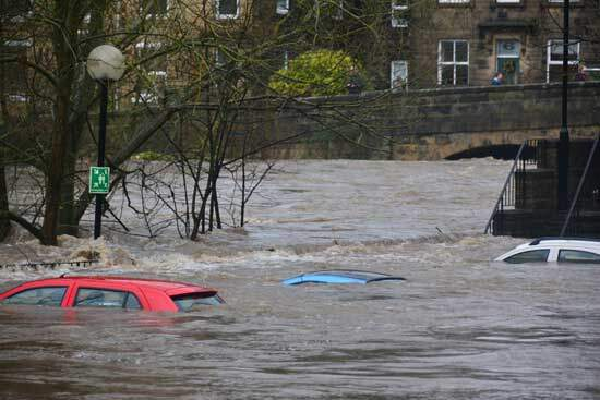 Cars under flood waters as we try to explain natural evils like famines, pestilences, floods, earthquakes & other disasters