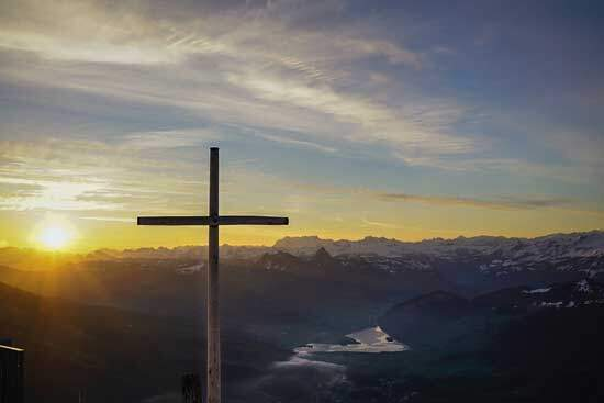 Cross of Christ, high & lifted up, where Jesus died as our Substitute, sunlight spreading across the mountains & river
