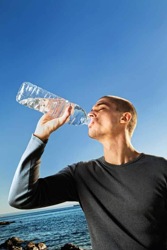 Man drinking water as water has always been large part of our existence & clean water provides wonderful health benefits