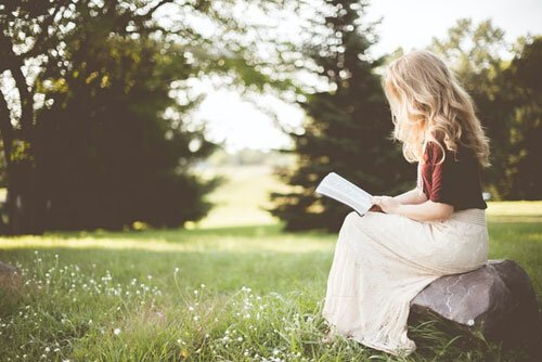 Adventist student reading the Bible as the Education system's greatest focus is on the spiritual growth of the students