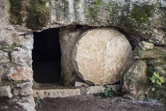 Empty tomb of Jesus Christ with the stone rolled away at His resurrection when He conquered death & gave us hope of eternity