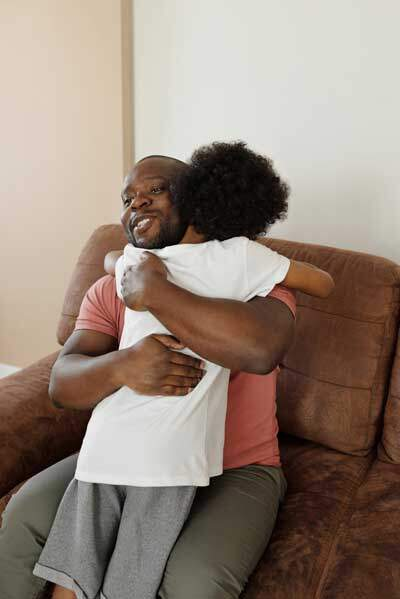 """Father hugging his son as father of prodigal son """"had compassion & ran & fell on his neck & kissed him"""" when he returned home"""