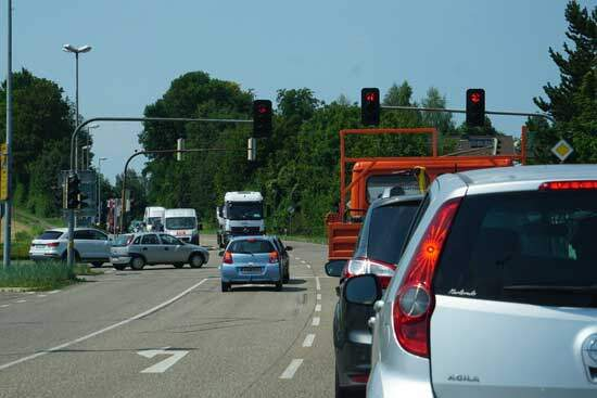 Red light at traffic intersection as God's law shows us our duty towards Him and each other but doesn't help us to follow