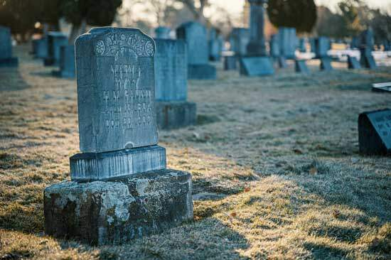 Tombstone as Bible says that dead sleep in the grave, awaiting future judgment after the resurrection