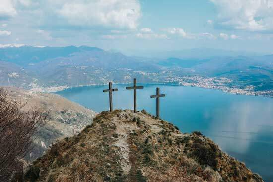 3 crosses on a hill near a sea reminding us Jesus's words in Matthew 20:28 that He came to give His life as a ransom for many