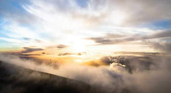 Light piercing through thick clouds, during the glorious event of Christ's Second Coming when the dead in Christ rise first